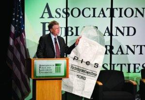 Bill Gates displays a Purdue Improved Cowpea Storage bag